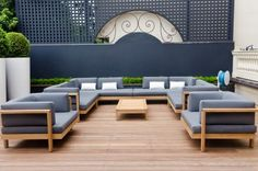 Designer Sean Weatherill honed a dilapidated playground into a modern back patio. Lined in warm and durable ipe wood, the deck will wear beautifully. Sleek outdoor furniture from Henry Hall provides the only neccesary decor.