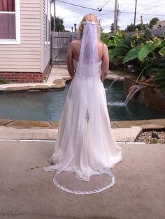 Floor length bridal veil hand beaded with Swarovski rhinestones, crystals and pearls.