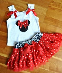 ok. soo i'm NOT a big DIsney Fan...I know I know...but this lil tshirt with those cute lil bows, different applique? OMGeeeeee My Cricut and me could have some creative FUN!!!!!!!