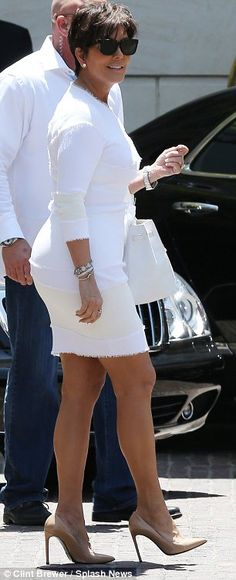Flaunting her pins: Kris Jenner showed off her toned legs in her tiny minidress