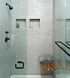 Modern Studio Apartment - the shower seat would be convenient for shaving your legs or taking a break to sit and detangle your hair without having to leave the shower