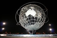 """Unisphere, Flushing Meadows-Corona Park, Queens    The Unisphere, located in Flushing Meadows-Corona Park, was the centerpiece and visual logo of the 1964-65 New York World's Fair, symbolizing the theme of """"Peace Through Understanding."""" It was designed"""