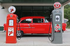 Candy Apple Red 55 Chevy in a Texaco Station