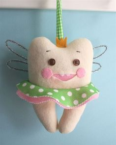 free pattern for tooth fairy pillow.  I love the tooth's 2 little front teeth!
