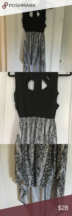 Open Back High Low Black & White Colorblock Dress Sexy strappy black and white patterned & colorblocked high low dress. Fun for a hot summer day! Can be worn w strappy flat sandals and big earrings for a boho looks or more elegantly w espadrilles and sparkly bangles. Material is t shirt like & stretchy and the strap in back has elastic No stains holes or tears, just a bit of fading from going thru the wash but still plenty of life left! I am 90% sure I got this from ASOS, if not then a…