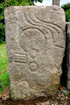 Class I Pictish Symbol Stone, Drummies Farm, Inverurie, Aberdeenshire, Scotland - this carved red granite stone boasts both S and Mirror and Comb symbols.