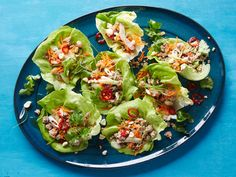 Lettuce Wraps - Super-colorful lettuce wraps filled with zesty Asian-style ground meat and all the fixings. http://www.foodnetwork.com/recipes/food-network-kitchens/lettuce-wraps.html