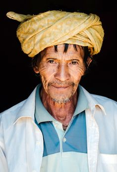 A tea-farmer poses for a portrait in the hills of Shan State, Myanmar.