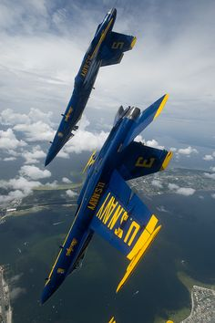 The Blue Angels maneuver over Pensacola Beach. by Official U.S. Navy Imagery
