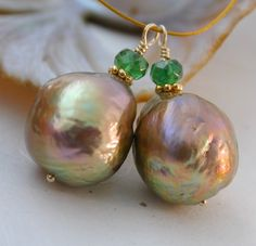 A matched set of freshwater baroque pearls (with 18k gold and tsavorite accents). These are called Kasumi pearls, but they're from China instead of Japan so they're really Kasumi-like. Ever since I found out about freshwater baroque pearls and how crazy beautiful they are, I've gotten a little obsessed.