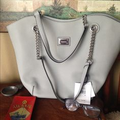 Calvin Klein handbag Beautiful soft gray leather handbag. 11x18x13 with drop of 10 inches. The handbag is beautiful and in perfect condition. No rips, tears or stains. Calvin Klein Bags Shoulder Bags