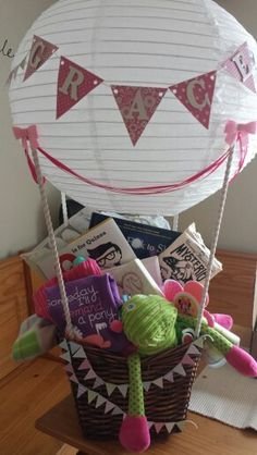 Hot air balloon baby gift basket! Lots of hot glue, but turned out perfect.