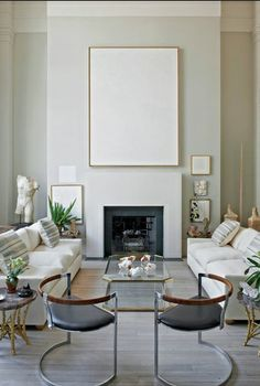 Romualdez's NYC living space--In Romualdez's New York apartment, chairs by Danish designer Poul Kjaerholm are flanked by petrified wood tables originally commissioned by Christian Dior.