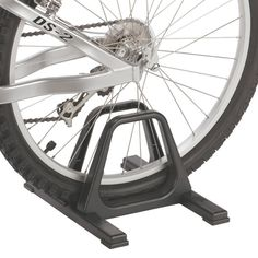 """The Grandstand single bike rack offers portable, lightweight storage   Ideal take-along storage for races and rallies   Engineering grade ABS plastic molded construction is rugged and waterproof and adjustable to fit tires up to 2 1/4 """" wide"""