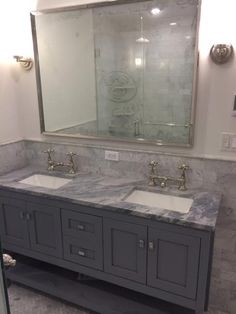 This appealing all white master bath includes a pair of Strasser