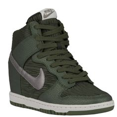 "NIB Women's Nike Dunk Ski Hi's pewter/carbon green For the days when you can't decide if you're feeling sneakers or heels -- the Nike Dunk Sky Hi Premium. Nike takes their iconic 1985 hoops style and pairs it with a 2.6"" wedge heel, providing you with the ideal mix of sports meets high-fashion style.  Premium leather and textile upper. Lightweight EVA midsole. Rubber outsole. Nike Shoes Sneakers"