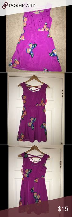 Purple Short Summer Sun Dress w/ Butterflies XS NWT Short purple summer dress with cute butterflies! Perfect for over your swimsuit or to grab a bite to eat on a nice summer day! Ideal for vacation season  Thank you for visiting my closet! Xhilaration Dresses