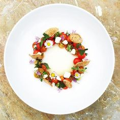 Deconstructed Bruschetta with goat cheese, garden herbs and edible flowers •…