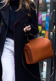The bag that will take you seamlessly from day through to night? Roksanda Ilincic's leather bowling bag - as seen at Paris Fashion Week.