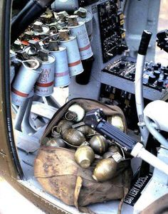 Loach cockpit showing smokes and the grenade bag filled with tear gas, baseball grenades, M26 grenades and white phosphorous. Also visible is the makeshift cyclic stick for the Scout in the event the Pilot is shot.