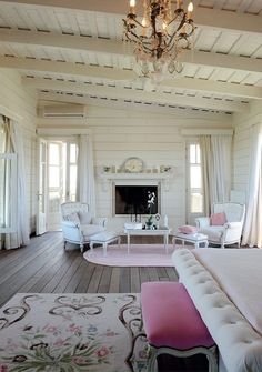 Pretty with a vintage vibe: love the windows, fireplace, the slant and the ceiling....