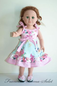Floral blue pink Easter or birthday doll dress with matching shoes, great small gifts for little girls. The sundress is handmade with some shabby and romantic chic floral cotton fabrics in the shades blue pink and white as well as a pink white polka dot fabric. The dress is hemmed