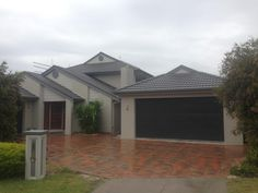 Taubmans taupe stone coloured finish to double storey home