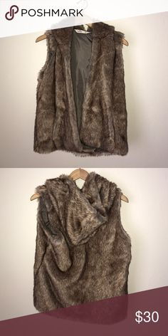 Hollister Faux Fur Vest With Hood💕 Hollister Faux Fur Vest With Hood💕. Excellent preowned condition!  65% acrylic 35% polyester. Open style, no closure. Pockets in front, hood is attached and cannot be removed. Gorgeous! Hollister Jackets & Coats Vests