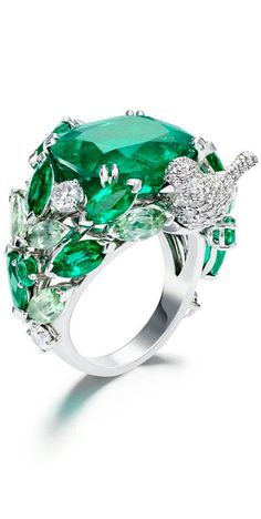 Piaget Rose Passion ring in white gold, set with diamonds and marquise cut and princess cut tourmalines. http://www.thejewelleryeditor.com/jewellery/article/floral-tribute-the-new-rose-passion-high-jewellery-collection-by-piaget/ #jewelry