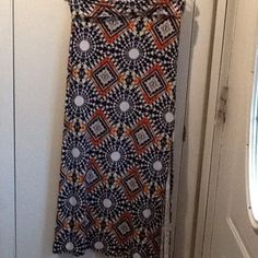 Charlotte Russe fold over maxi skirt Charlotte Russe fold over maxi skirt with 2 side slits.  Size large.  White, blue, orange, black and yellow. Charlotte Russe Skirts Maxi