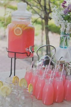 Romantic Pink Drinks for Engagement Party. Fill the large sized glass jar with pink juice. You can add lemonade slices for fresh flavor. You can turn on the tap to add you sweet and romantic engagement party drinks.
