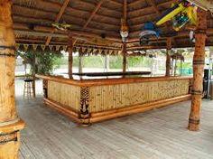 Tiki hut with tiki bar. Love the bar area. Deco Restaurant, Outdoor Restaurant, Backyard Bar, Backyard Games, Diy Außenbar, Bamboo House Design, Deck Bar, Diy Outdoor Bar, Outdoor Pool