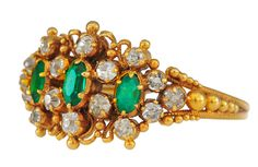 A QUITE DELICIOUS HIGH CARAT GOLD RING, FEATURING CANNETILLE WORK, RICH EMERALDS AND OLD  BRILLIANT CUT DIAMONDS. CIRCA 1820