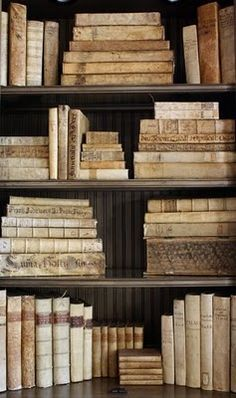 """Antique vellum books are getting quite popular in decorating circles.  They are very beautiful but as an avid reader my biggest pet peeve is book shelves filled with """"books by the yard"""" that look good but you know no one reads. I love my books, re read them over and over and even though I love this look- its not for me."""