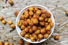 Spicy Roasted Chickpeas make a wonderful crunchy snack. They're high in protein and provide a tasty, nutritious snack any time of the day. Chickpea Snacks, Chickpea Recipes, Healthy Gluten Free Recipes, Vegan Snacks, Diet Recipes, Vegan Lunches, Fodmap Recipes, Party Recipes, Vegan Food