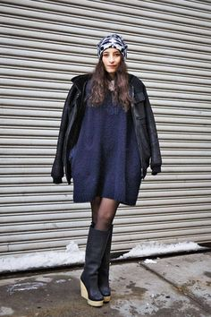 Maria Parra in a turban, high boots, and short sweater dress #NYFW #streetstyle #fashionweek