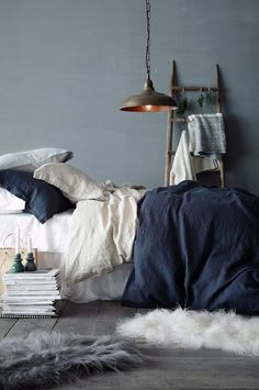 Winter Blues & Moody Hues | Winter Decor Inspiration | Dark Blue and White French Linen Bedding, Laid Back Storage Ladder, and A Pile of Books...Who Needs A Bed Frame!