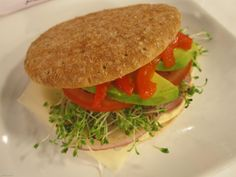 Veggie Sandwich with Chipotle Spread: Spread 1 wedge of Chipotle Queso Fresco Laughing Cow cheese on a whole wheat sandwich thin, and then layer on 1 slice low-fat cheese, sprouts, a few thin slices of avocado, sliced tomato, red onion, and roasted red pepper. Yum!