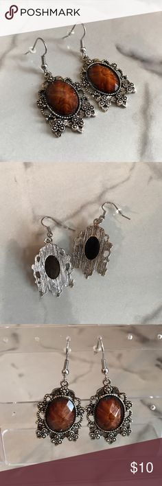 Amber & silver statement earrings Gorgeous and dressy!  An amber toned faceted gem embedded in antiqued silver detailed earring with fish hook style closures.  All earrings come with tags and backings and carefully packaged for a safe delivery. Jewelry Earrings