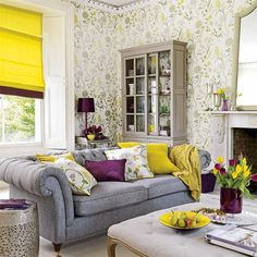 I love the couch  pillows + the gray/yellow/purple color combo. Cozy  pretty!