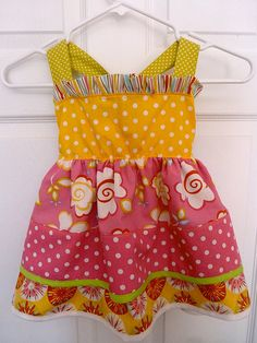 tutorial for cute little girl's sundress.  So adorable with different fabrics!  I think I could do this!