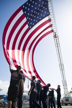 Firefighters raise the American Flag at Oceanside Harbor Days 2014.  Harbor Days 2015 will be September 26 & 27.