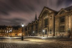 This photo is the main building of the University of Copenhagen from 1836. The University has fostered known people, one of the most famous is Hans Christian Oersted, who discovered electromagnetism in 1820.  This particular photo I had waited and waited to be able to take it. The square in front of the building is always crowded with people, buses, cars, etc. But this day, only one single car was there.  --Jacob Surland  Easy to read and understand tutorials on www.caughtinpixels.com …