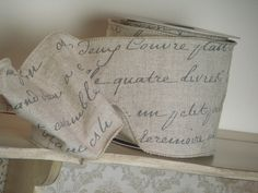 I can picture this wrapped around a wedding invitation, french script on linen ribbon.