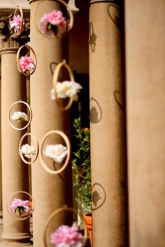 hanging decor / Now this is a clever idea.  I might not use the flowers though . . . might use something else instead, though not sure what.