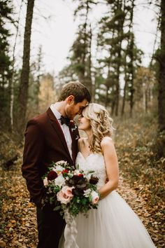 A sweet moment in the woods during a couple's session | Image by Ariana Tennyson Photography