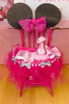 Decorated chair at a Minnie Mouse and Zebra Print Birthday Party!  See more party ideas at CatchMyParty.com!  #partyideas #minniemouse
