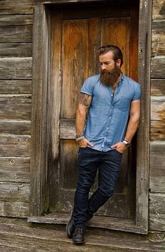 Man, tattoos, beard.