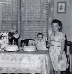 A birthday, complete with dolly and a horrid home perm.