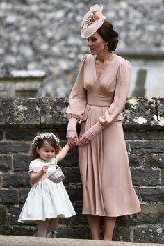 Catherine, Duchess of Cambridge stands with her daughter Princess Charlotte of Cambridge, a bridesmaid, following the wedding of her sister Pippa Middleton to James Matthews at St Mark's Church on May 20, 2017 in Englefield Green, England.